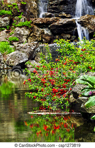 Cascading waterfall and pond - csp1273819