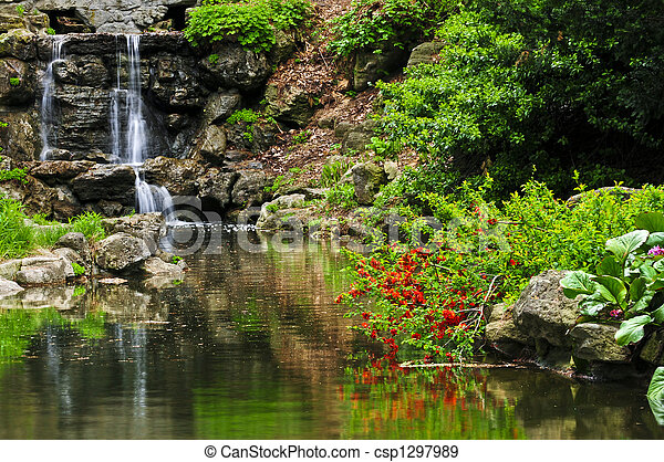 Cascading waterfall and pond - csp1297989
