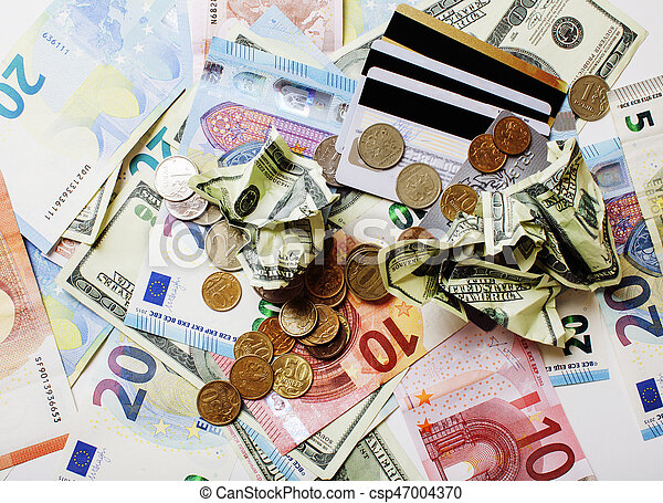 Cash on table isolated: dollars, euro, rubl broken money. All in mess, global crisis concept - csp47004370