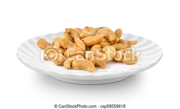 Cashews in plate on white background - csp58559618