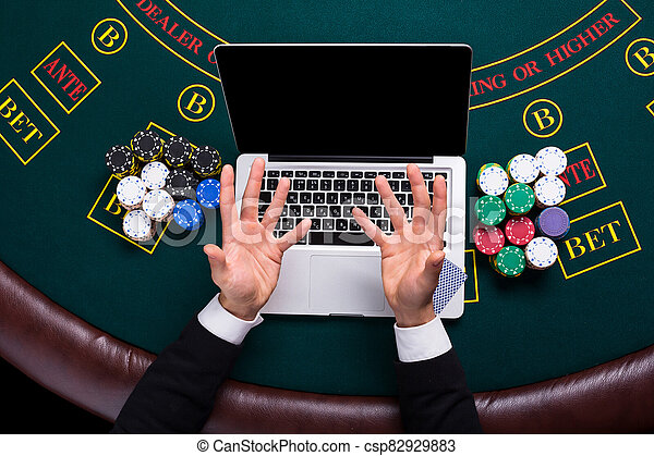 Casino Online Gambling Technology And People Concept Close Up Of Poker Player With Playing Cards Laptop And Chips At Canstock