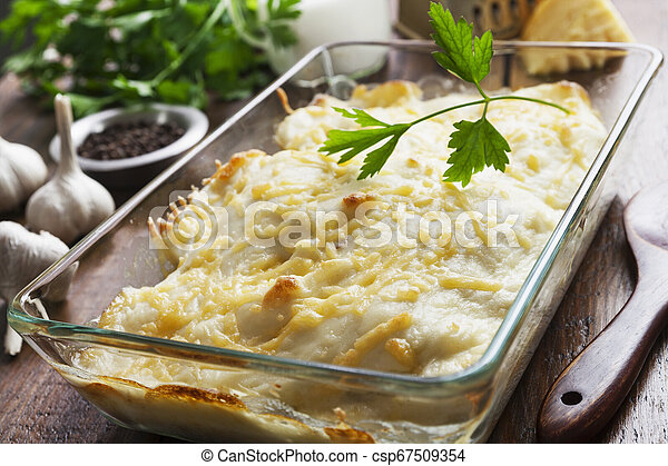 Casserole with fish and potatoes - csp67509354
