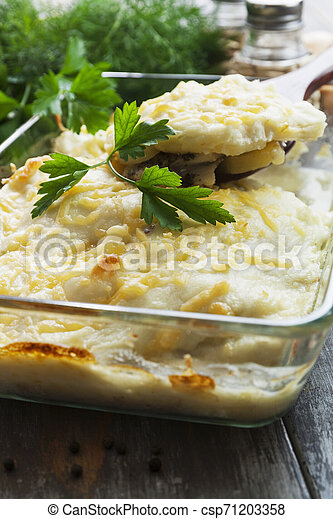 Casserole with fish and potatoes - csp71203358