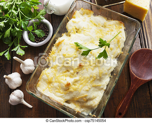 Casserole with fish and potatoes - csp75145054
