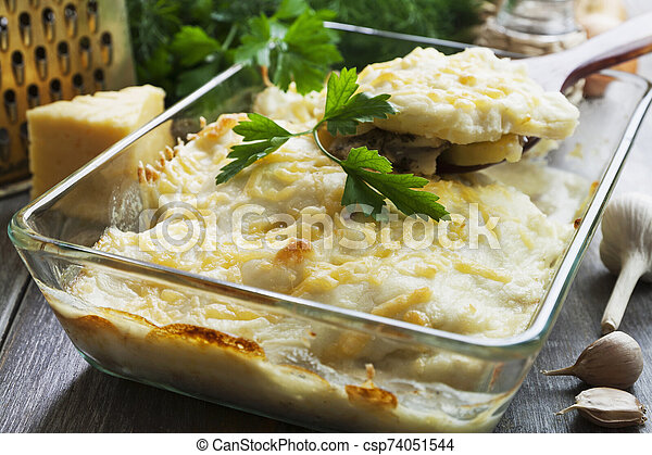 Casserole with fish and potatoes - csp74051544