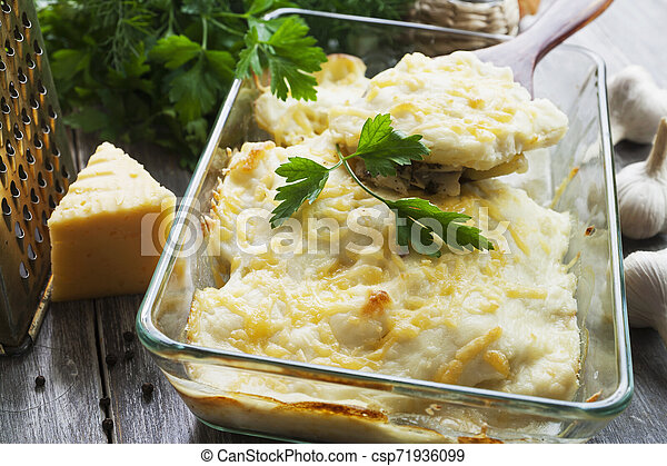Casserole with fish and potatoes - csp71936099