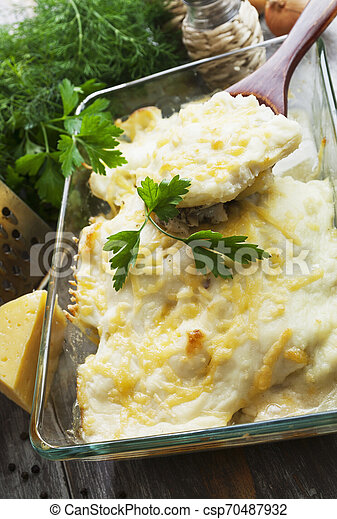 Casserole with fish and potatoes - csp70487932