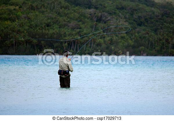 Casting for bonefish in Aitutaki Lagoon Cook Islands  - csp17029713