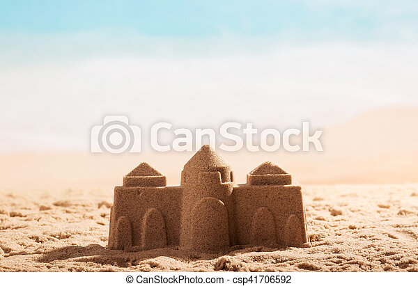 Castle in the sand close up on background of sea. - csp41706592