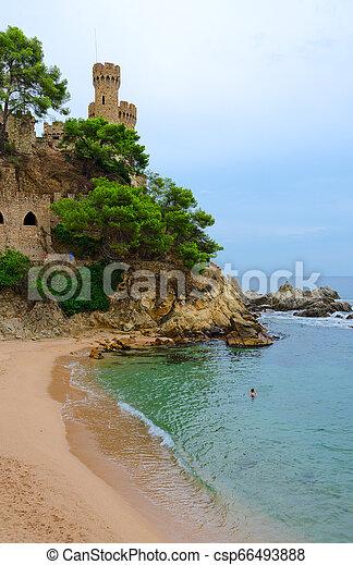 Castle on cliff by beach, Lloret de Mar, Costa Brava, Spain - csp66493888