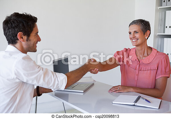 Casual business people shaking hand - csp20098813