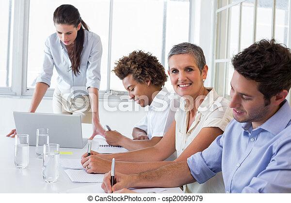 Casual business team having a meeting - csp20099079