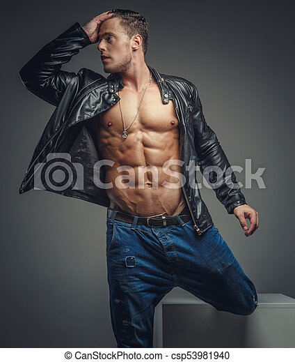 7841f2b32bc Casual muscular man in studio. Muscular male in blue jeans and black ...