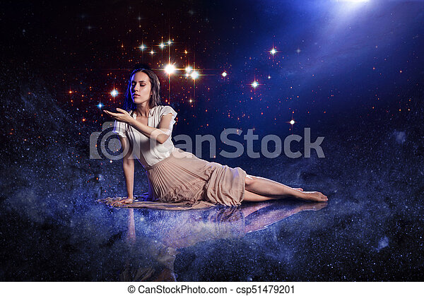 Catch a star, young woman dreams to starry sky. Elements of this image furnished by NASA. - csp51479201