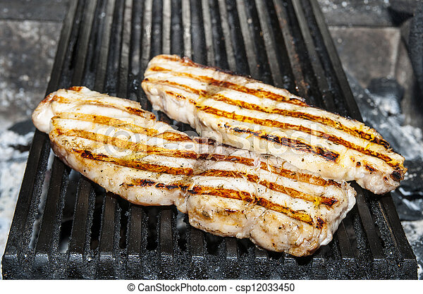 catfish meat on the grill - csp12033450
