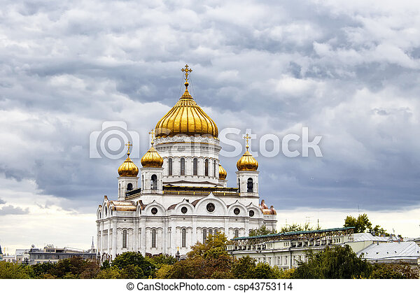 Cathedral of Christ the Saviour under dramatic clouds in Moscow. Gleaming domes top this Catholic edifice, rebuilt in the 1990s, with ornate, fresco-lined interior. - csp43753114