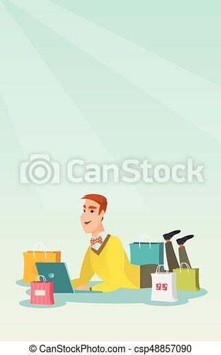 Un joven caucásico haciendo compras online. - csp48857090
