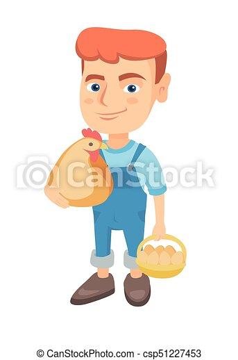 Caucasian boy holding a chicken and hen eggs. - csp51227453