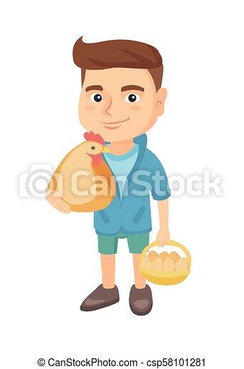 Caucasian boy holding a chicken and hen eggs. - csp58101281