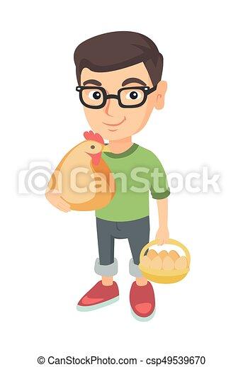 Caucasian boy holding a chicken and hen eggs. - csp49539670