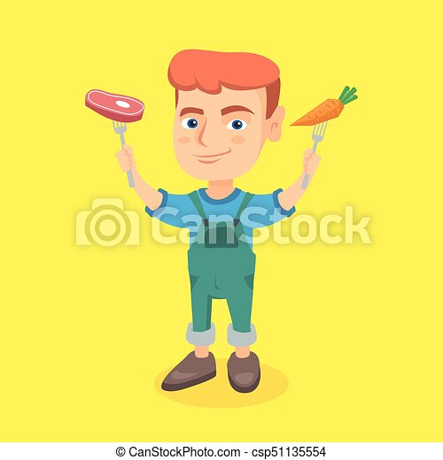 Caucasian boy holding fresh carrot and steak. - csp51135554
