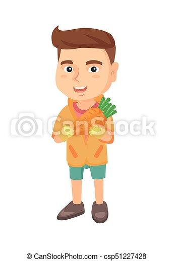 Caucasian boy holding fresh carrot. - csp51227428