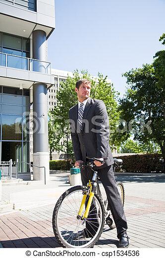 Caucasian businessman riding a bike - csp1534536