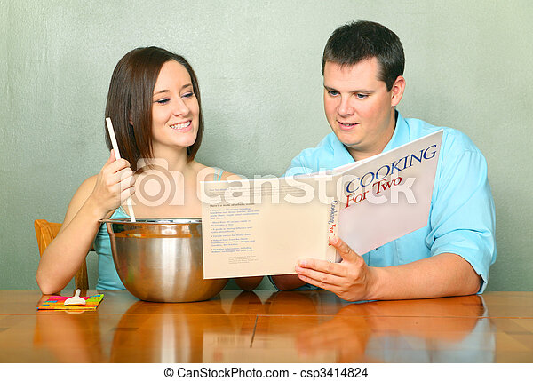 Caucasian Couple With Passion Of Cooking Or Baking - csp3414824