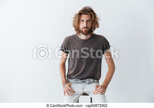 Caucasian handsome young bearded man standing isolated - csp50872952