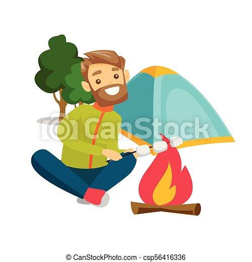 Caucasian Man Roasting Marshmallow Over Campfire