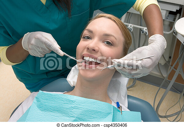 Caucasian Woman And African American Dentist Stock Photo