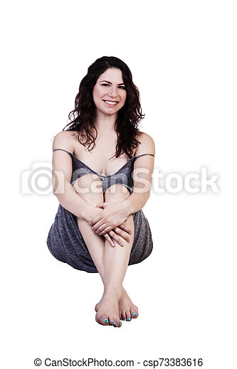 Caucasian Woman In Gray Dress Sitting On White Background - csp73383616
