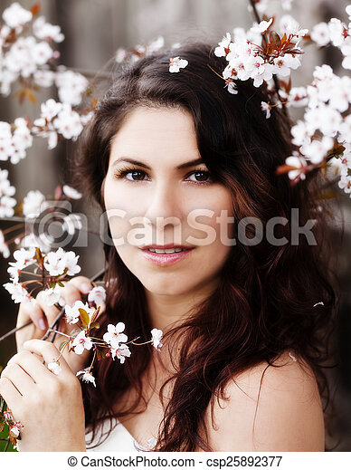 Caucasian Woman Portrait Among White Blossoms Outdoors - csp25892377