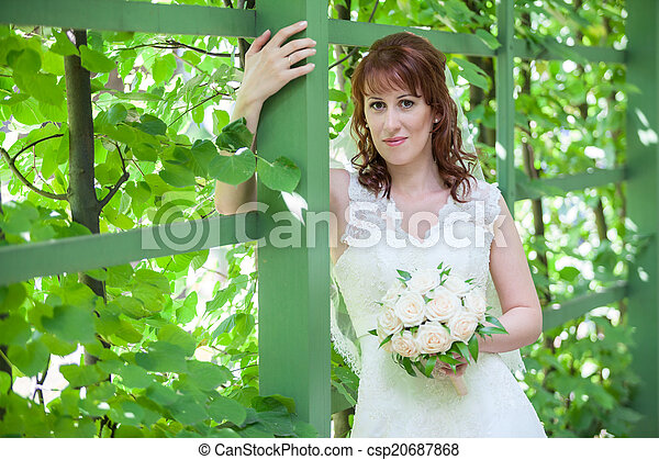 Caucasian woman portrait with green fence - csp20687868