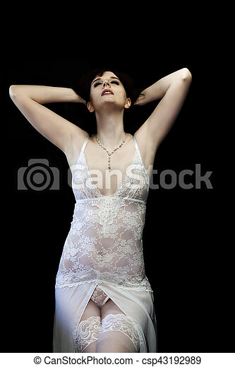 Caucasian Woman Sitting In White Lace Lingerie - csp43192989