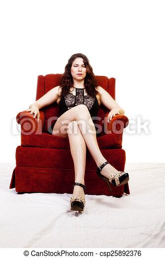 Caucasian Woman Sitting Regally In Black Dress - csp25892376