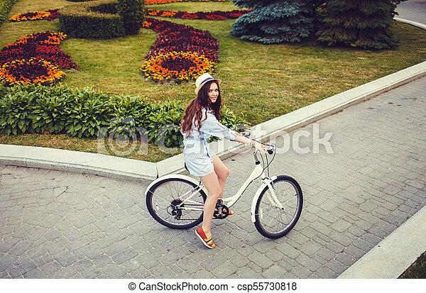 caucasian woman with her bike outdoor - csp55730818
