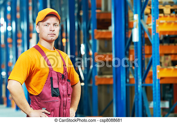 caucasian young manual worker in warehouse - csp8088681