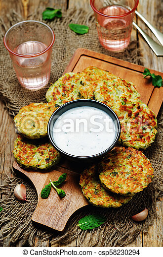 Cauliflower sweet potato Fritters with greek yogurt mint sauce - csp58230294