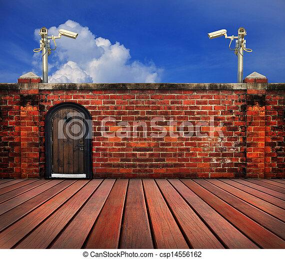 cctv camera and old brick wall - csp14556162