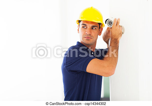 cctv technician adjusting camera angle - csp14344302