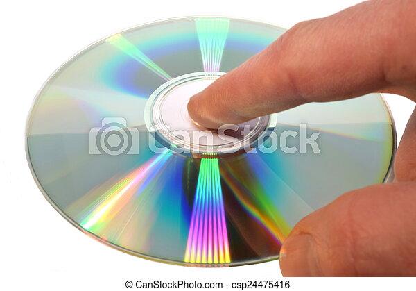 La mano atractiva sostiene CD, aislada - csp24475416