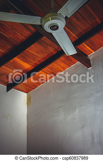 Ceiling Fan On A Brown Wooden Ceiling Ceiling Fan On The Background Of A Brown Wooden Ceiling Canstock