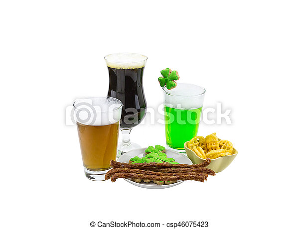 Celebration Patrick saint day beer tasting glass of green wheat lager and a glass of dark stout snack biscuits clover - csp46075423