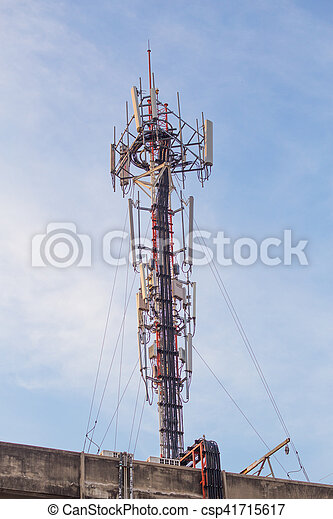 Cell site, Telecommunications radio tower or mobile phone base station with  atop the antennas with Blue Sky and cloud background