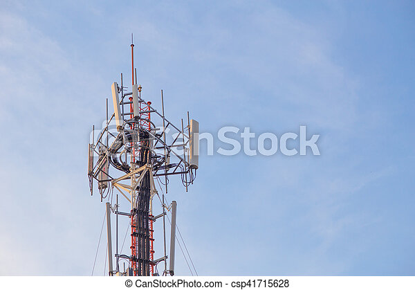 Cell site, Telecommunications radio tower or mobile phone base station with atop the antennas with Blue Sky and cloud background. - csp41715628