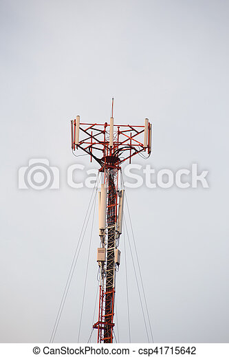 Cell site, Telecommunications radio tower or mobile phone base station with atop the antennas isolated with white sky background. - csp41715642