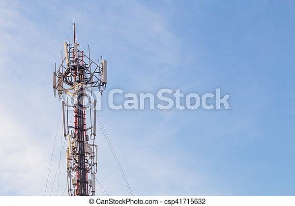 Cell site, Telecommunications radio tower or mobile phone base station with atop the antennas with Blue Sky and cloud background. - csp41715632