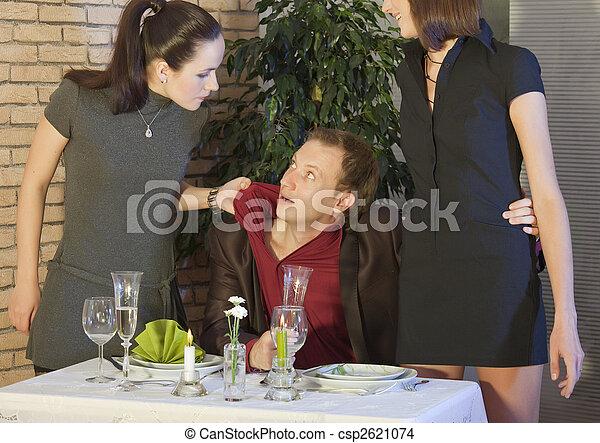 Escena de celos en el restaurante - csp2621074