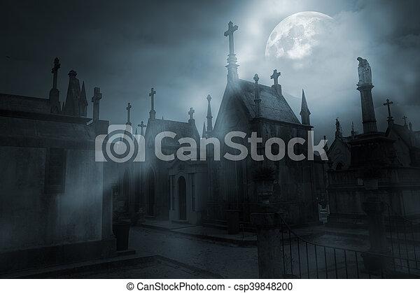 Cemetery in a foggy full moon night - csp39848200